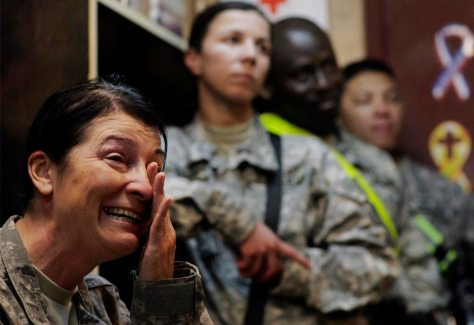 US Army Command Sgt. Maj. Julia Kelley, left, of the 229th Brigade Support Battalion, 2nd Heavy Brigade Combat Team, 1st Infantry Division, weeps as she watches the inauguration of US President Barack Obama at Camp Liberty in Baghdad, Iraq, Tuesday, Jan. 20, 2009.